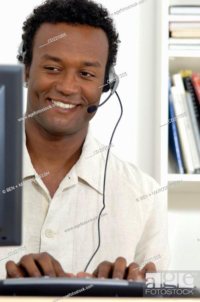 Stock Photo: Black man at work.