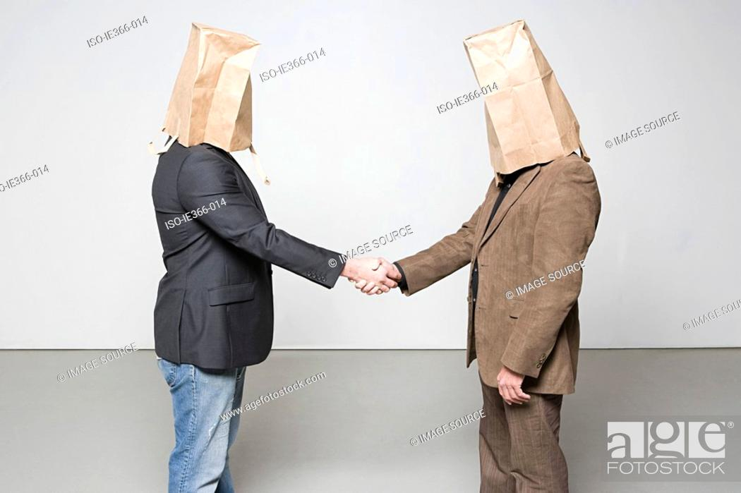Stock Photo: Men with paper bags on their heads.